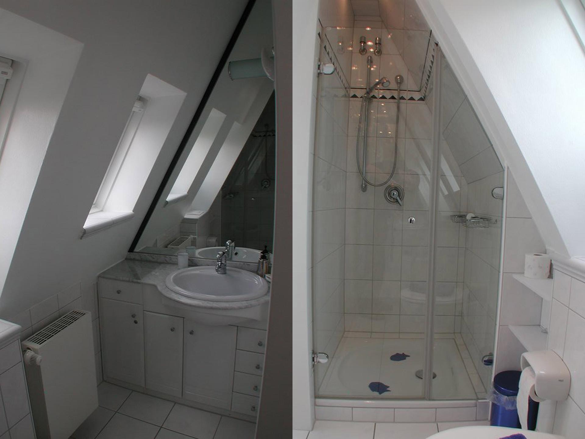 Das hochwertige Badezimmer inkl. Dusche und großen Fenstern