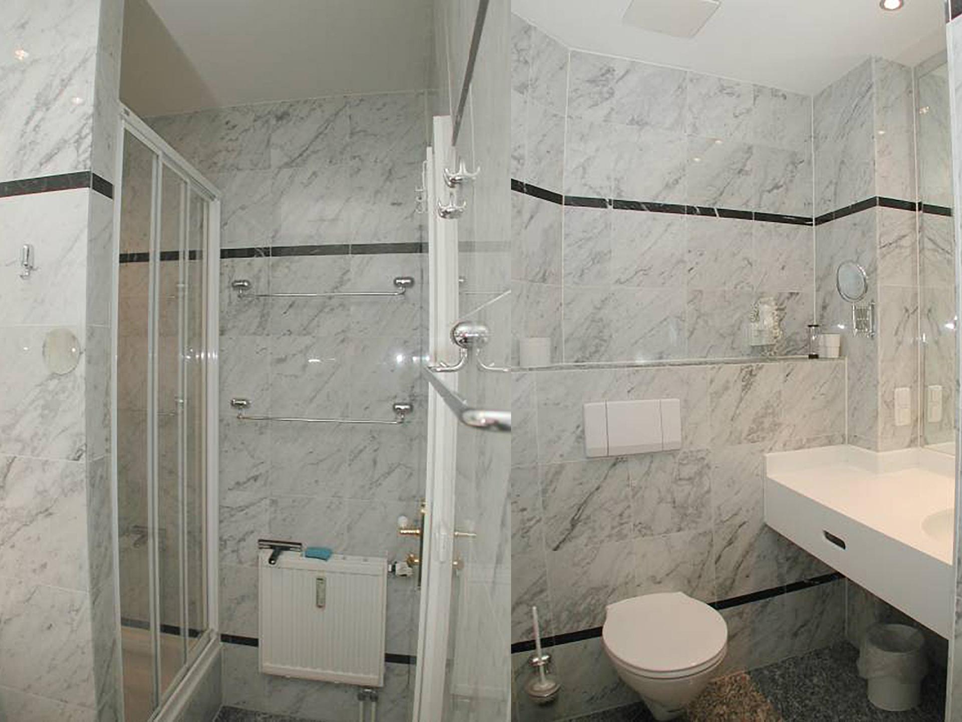 Das exklusive Marmor Badezimmer mit großer Dusche und großem XL Waschbecken